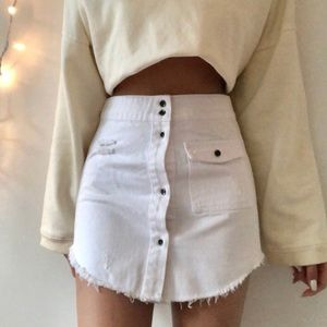 DEAD Studios distressed white denim mini skirt